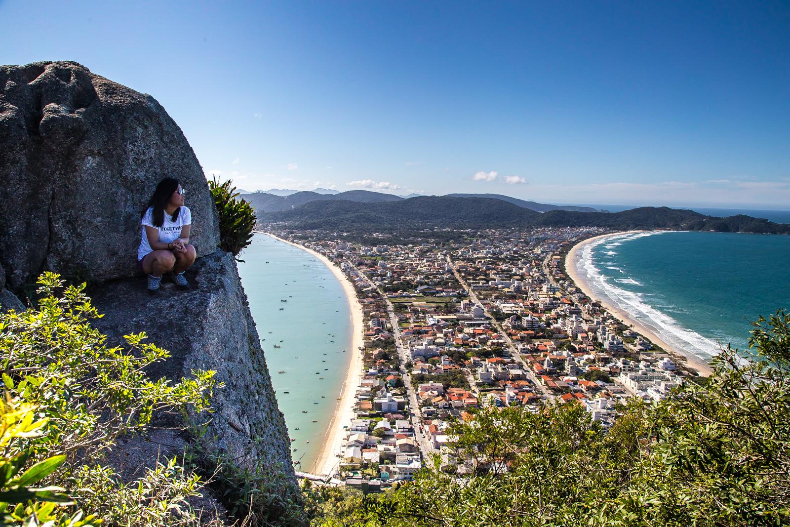 Julie perched on a rock in Bombinhas, Brazil
